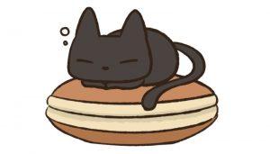 ドラ焼きの上で寝る猫